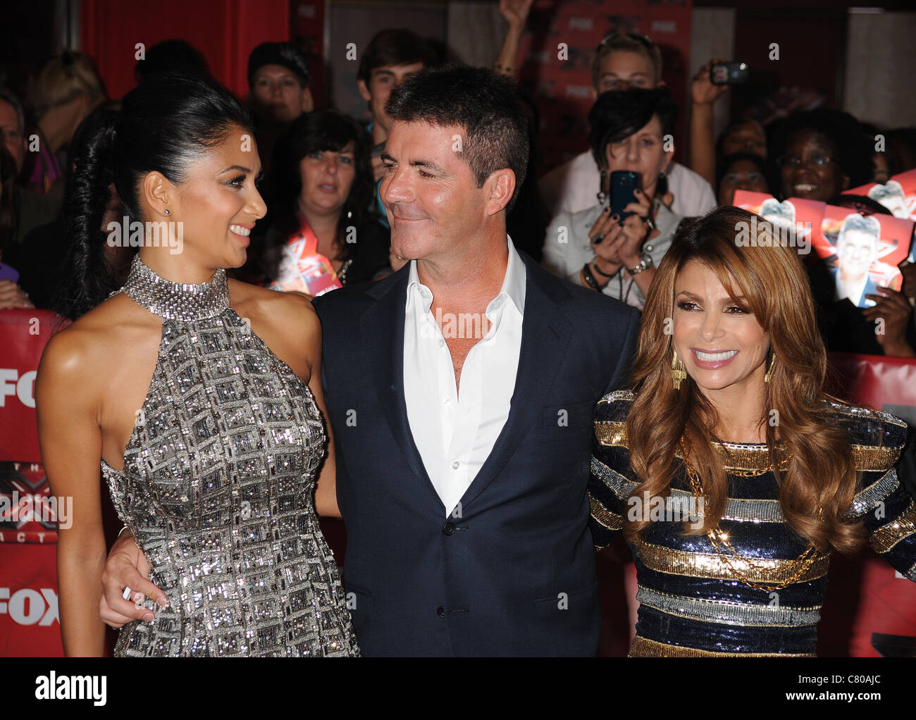 THE X FACTOR (US) Simon Cowell  judges singer Paula Abdul at right and singer Nicole Scherzinger in 2011. Photo - Stock Image