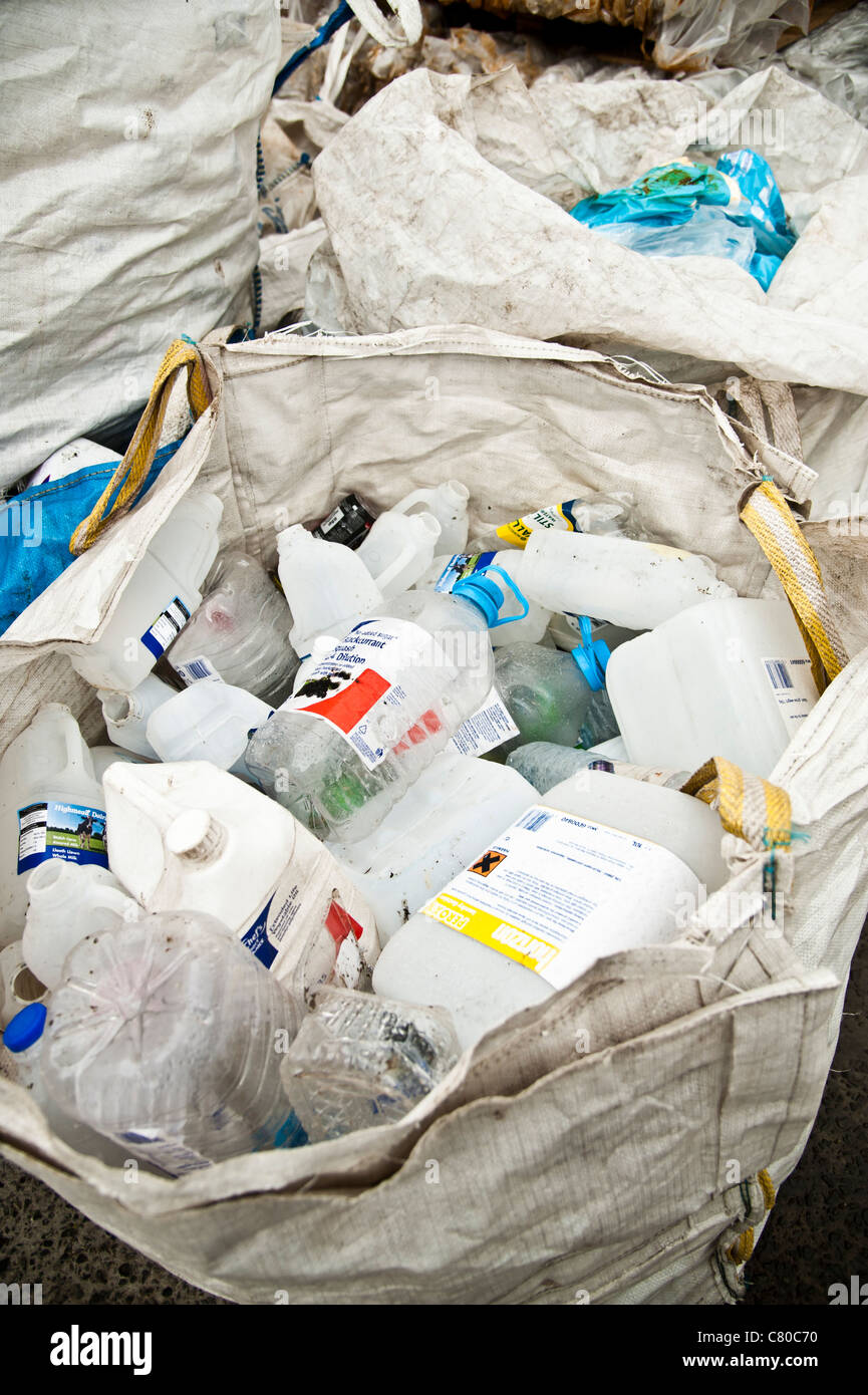 Sacks of waste bottles and cans awaiting compacting at s recycliong centre UK - Stock Image