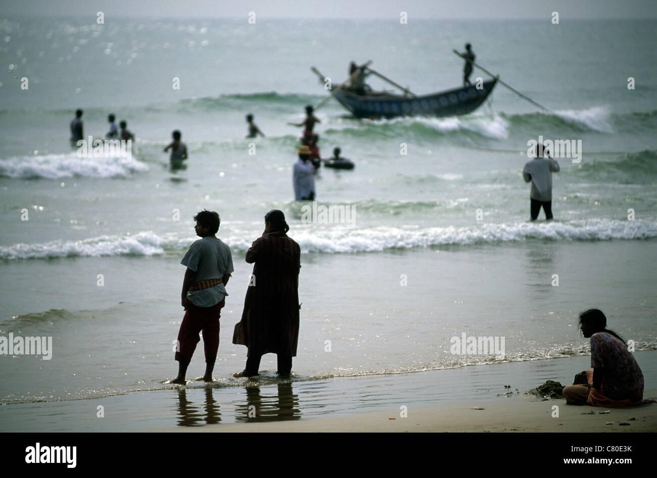 India, Orissa, Puri,fishermen on beach Stock Photo