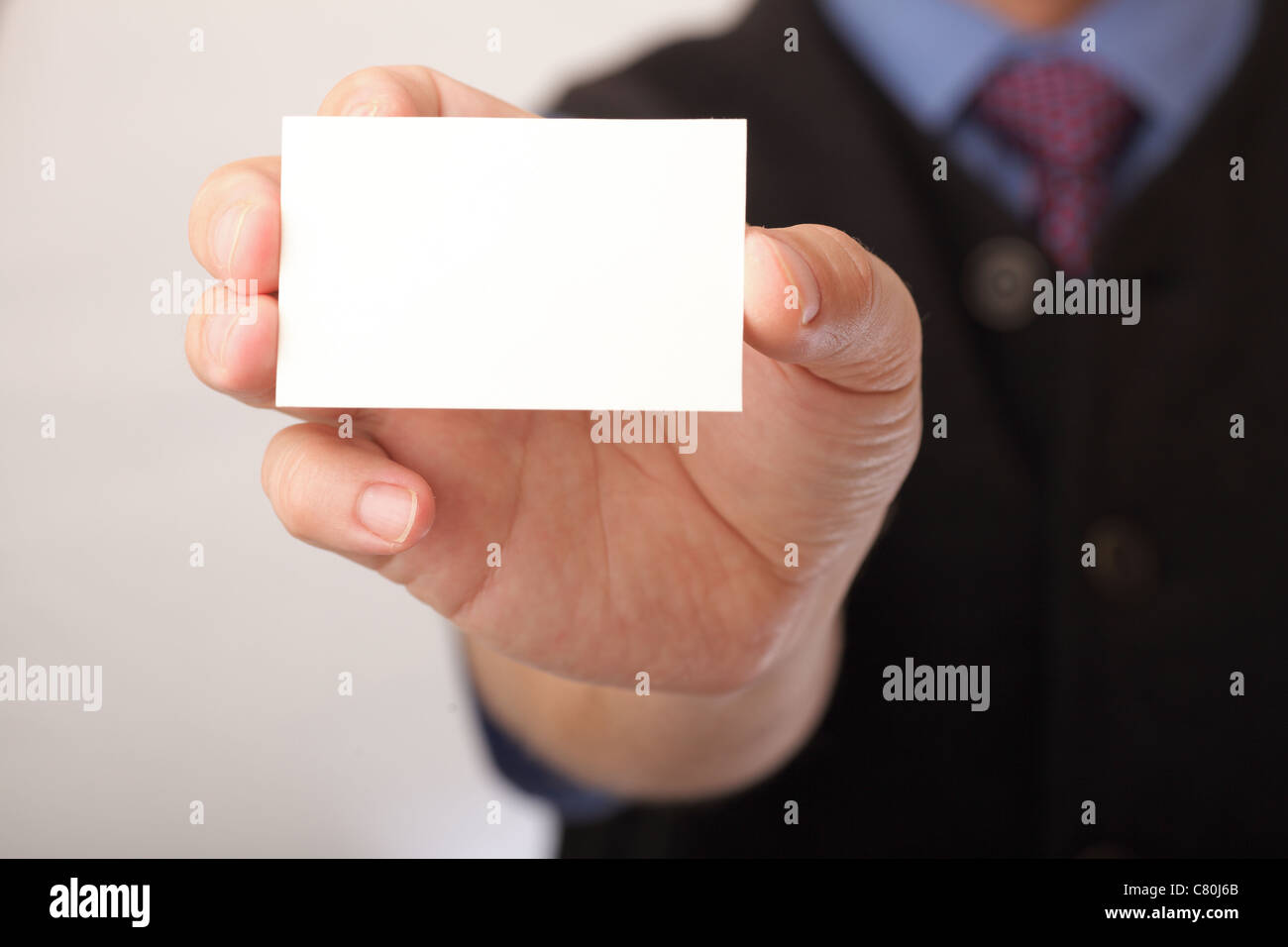Businessman showing business card focus on fingers and card you businessman showing business card focus on fingers and card you can just add your text there colourmoves