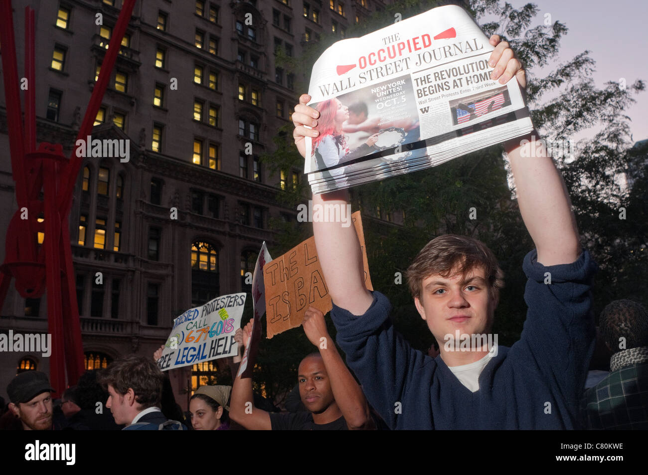 Anti Wall Street protesters distribute copies of the Occupied Wall Street Journal - Stock Image
