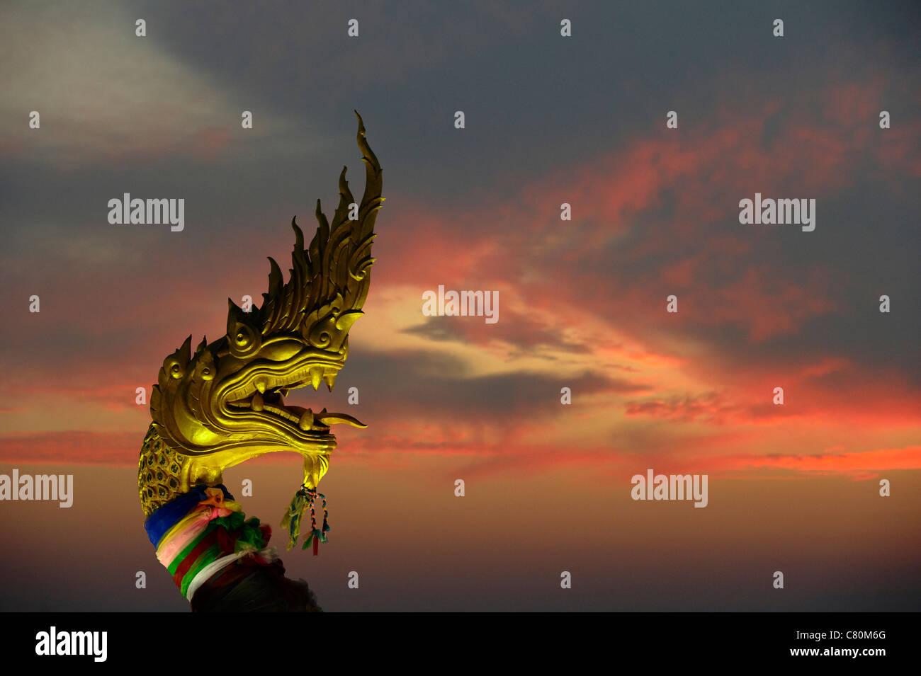 Thailand, Phuket island, Karon beach, Buddhist Shrine at Sunset - Stock Image