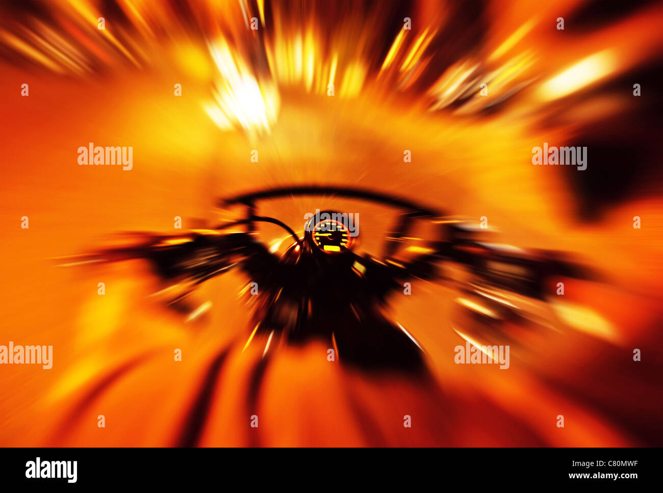 Abstract red slow motion speed background, selective focus on speedometer, night motorbike ride - Stock Image