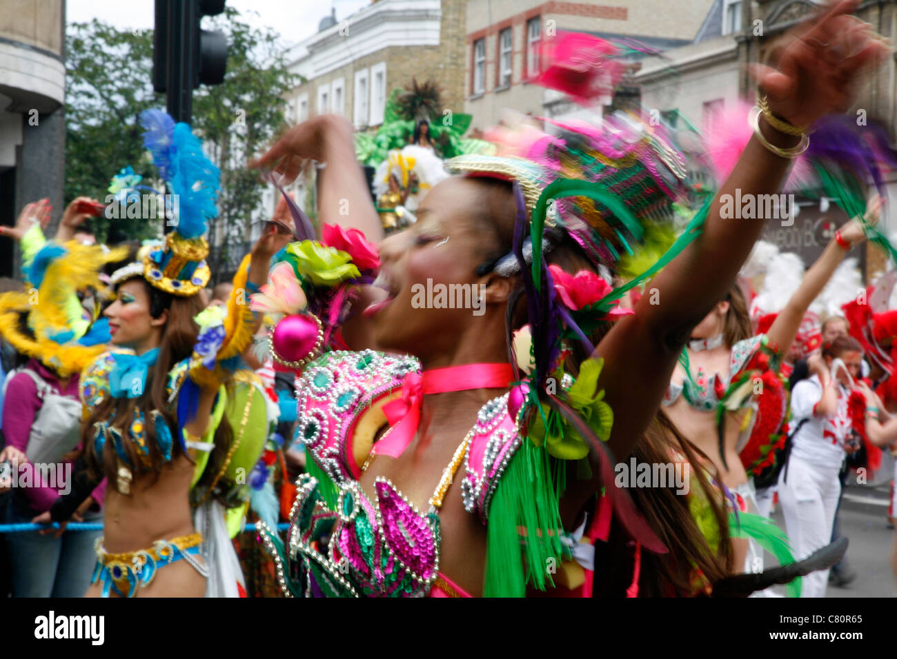 Costume (or Mas) parade at Notting Hill Carnival, Notting Hill, London, UK - Stock Image
