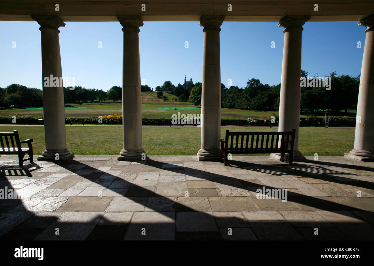 View through the colonnade of the National Maritime Museum to the Royal Observatory in Greenwich Park, Greenwich, - Stock Image