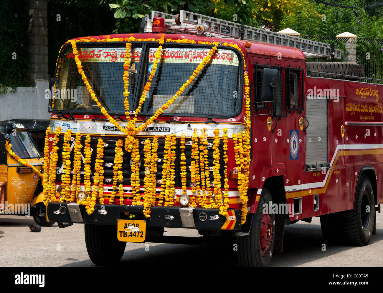 Indian Fire Engine Covered In Flower Garlands During The Hindu Festival Of  Dasara. Andhra Pradesh