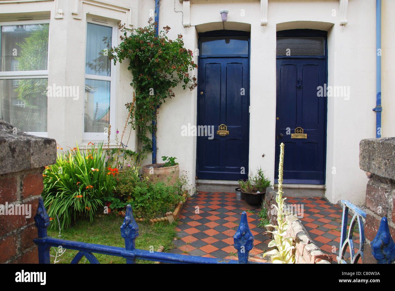 front doors with checkered path Moretonhampstead England - Stock Image