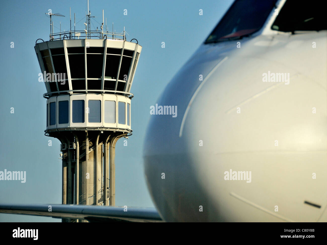 Air traffic control tower and aeroplane at Airport Saint Exupery, Lyon, France - Stock Image