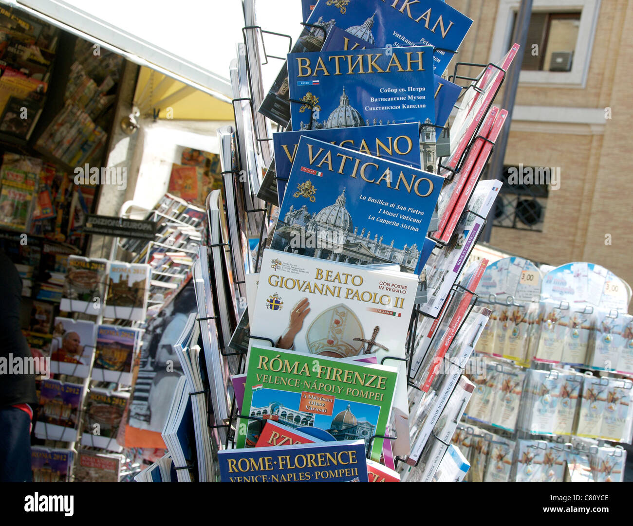 Postcards in a rack, Rome, Lazio, Italy, Europe - Stock Image