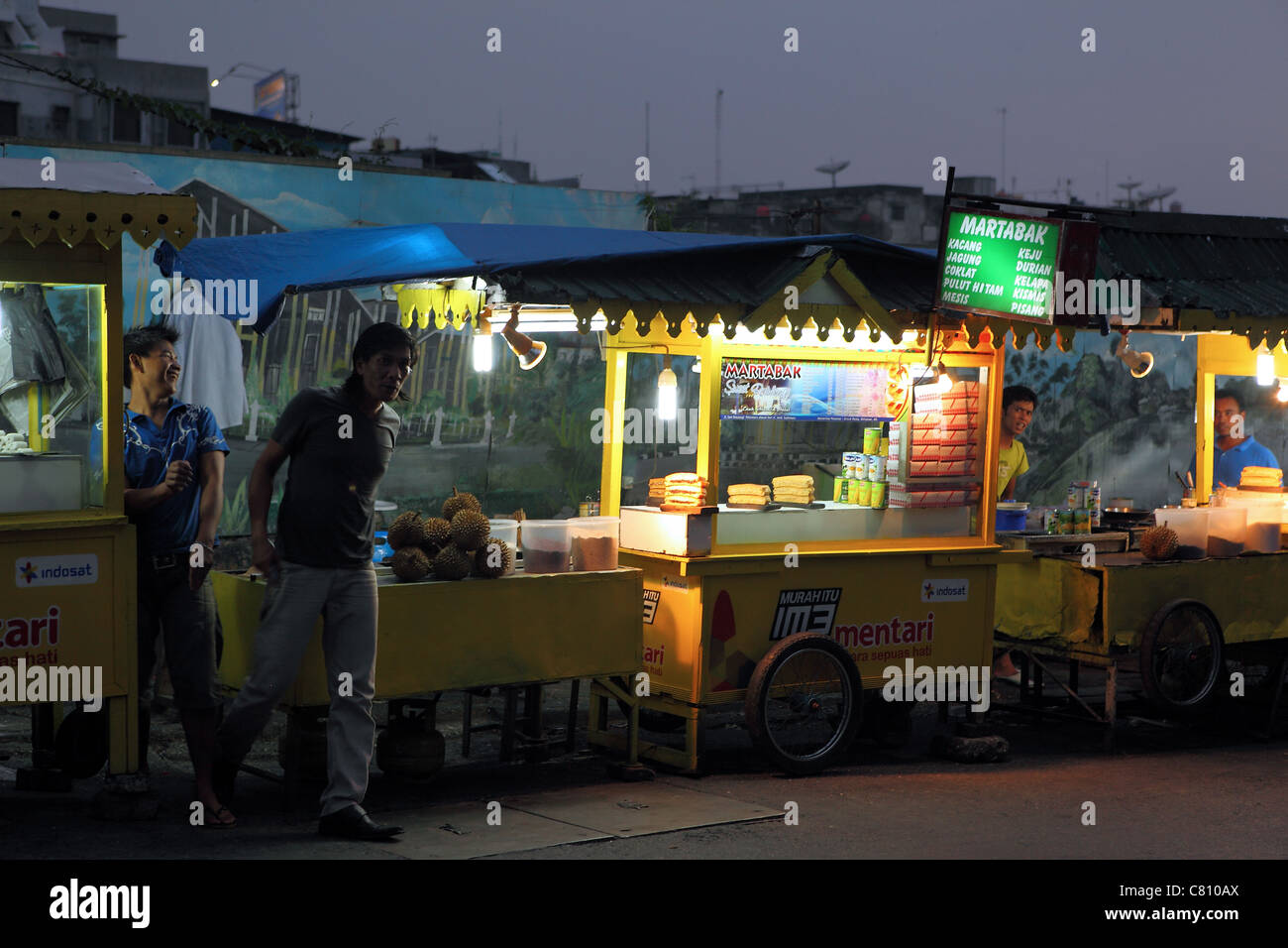 Street food carts at dusk in Pekanbaru - Stock Image