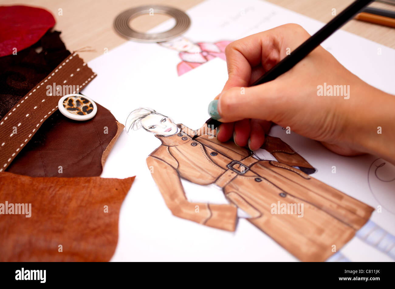 Fashion designer is drawing a fashion sketch for autumn