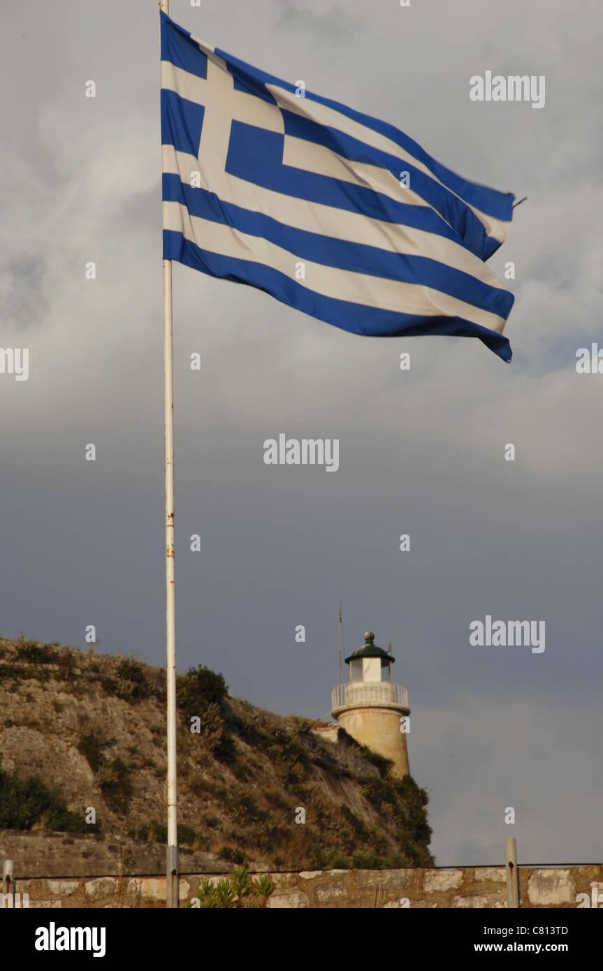 Greece flag waving at the Old Venetian Fortress. Corfu. Ionian Islands. Greece. - Stock Image