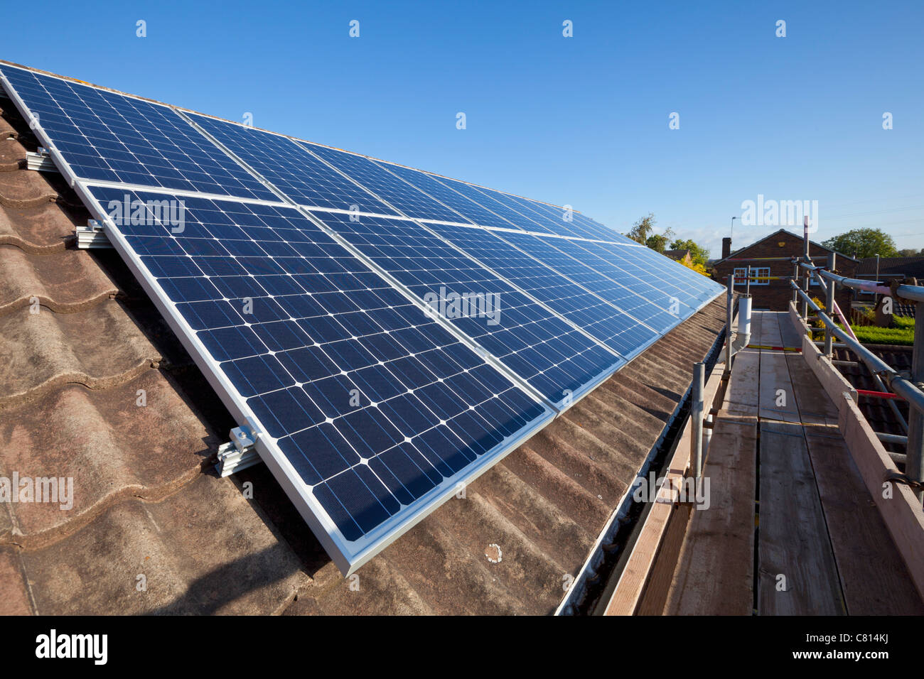 solar panels on house roof england uk gb eu europe - Stock Image