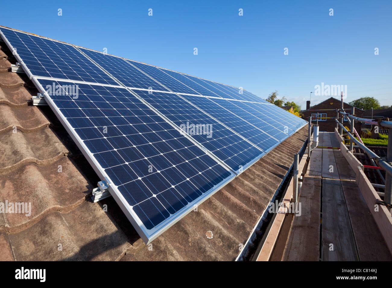 solar panels on house roof england uk gb eu europe - Stock Image