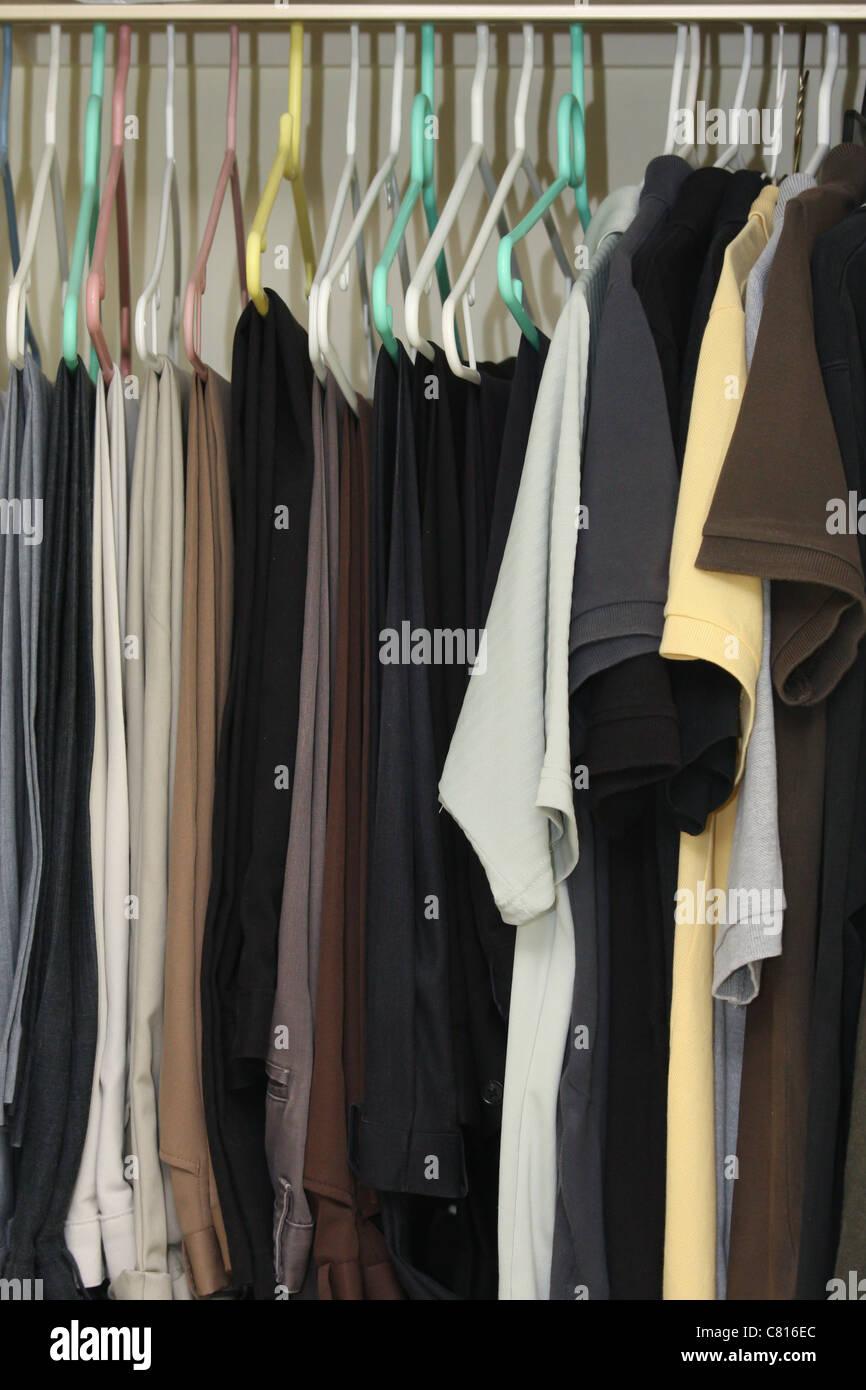 men closet hangers pants polos - Stock Image