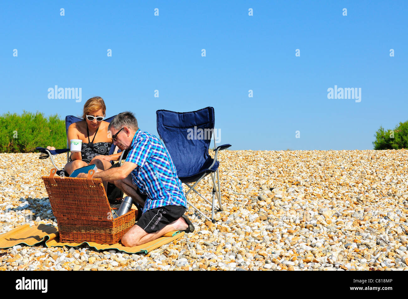 Couple picnicking on West Wittering's beach on  'the hottest  day of the year'  -surprisingly  on Autumns October - Stock Image