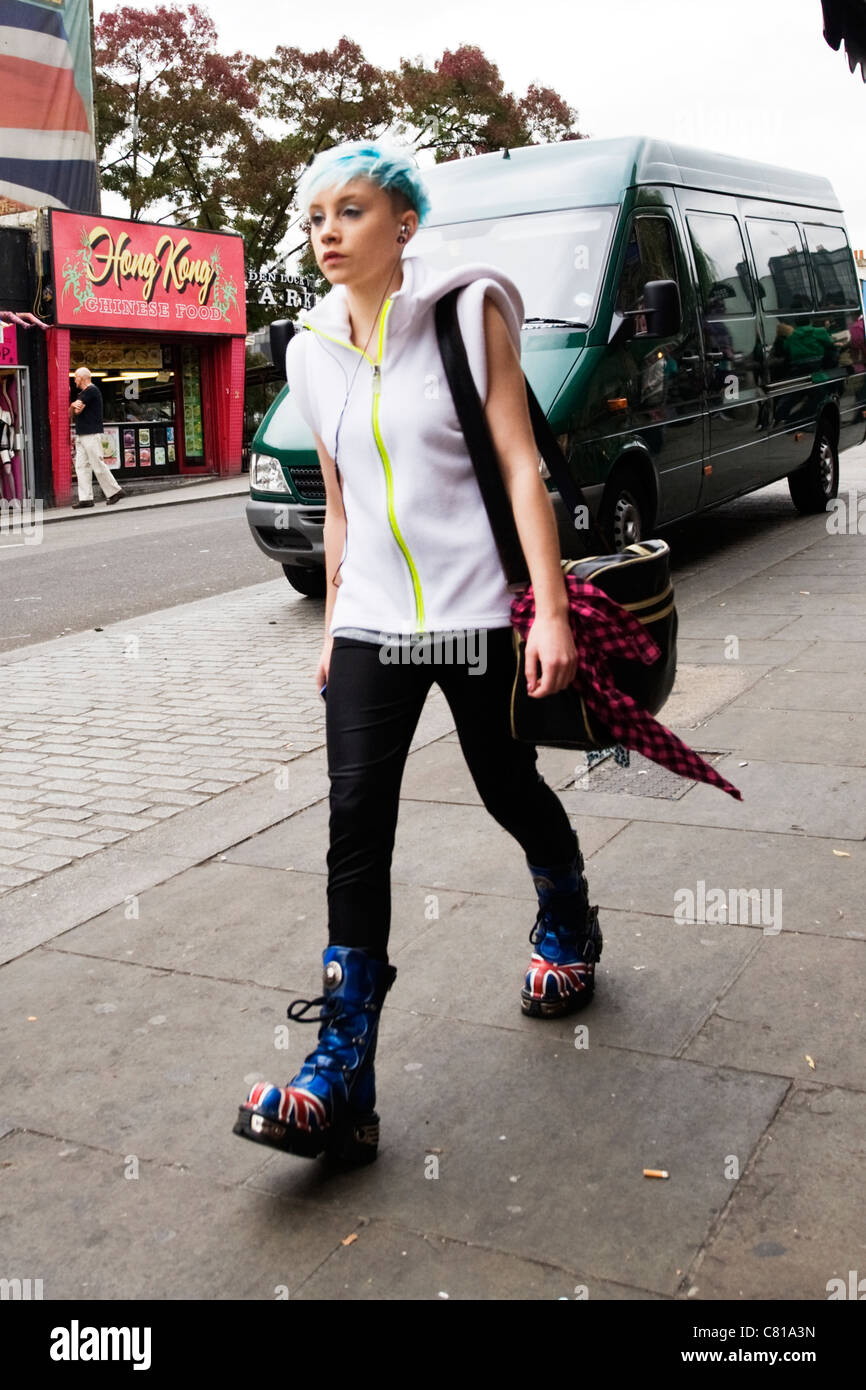 5fa4162e754 London Camden Town Lock Stables market pretty young punk girl walking with  blue hair blue Dr
