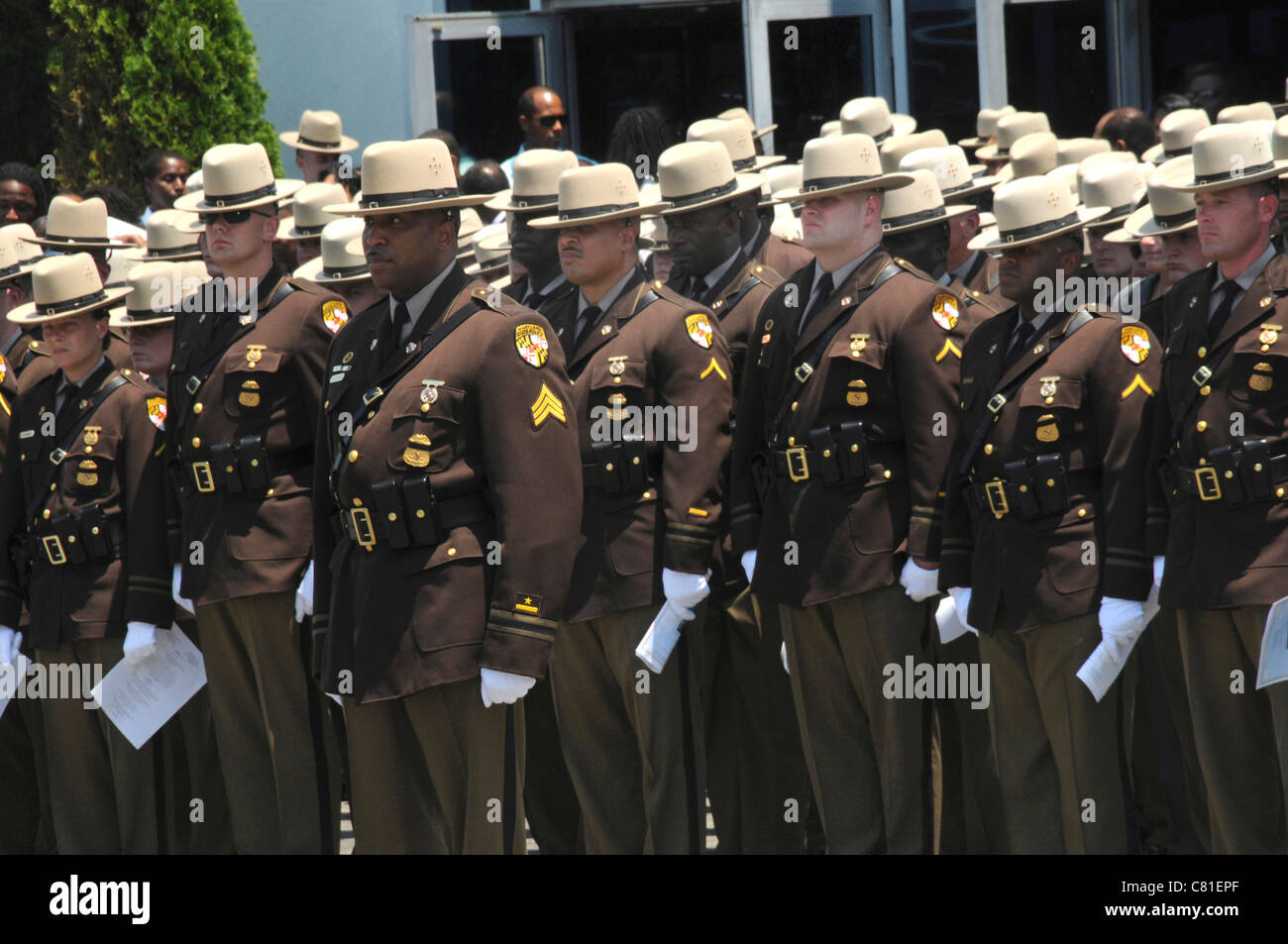 Maryland State Troopers stand at attention at the funeral for a Maryland State Trooper who was killed in the line - Stock Image