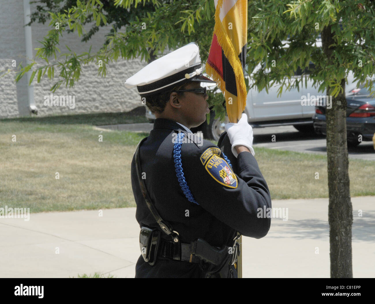 A Baltimore City policeman stands at attention at the funeral for a Maryland State Trooper who was killed in the - Stock Image