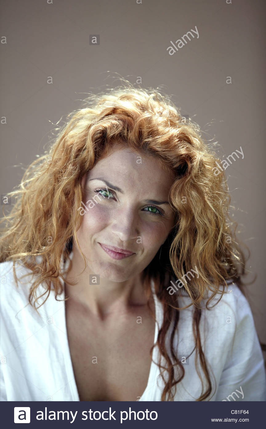 Portrait of red-haired woman - Stock Image