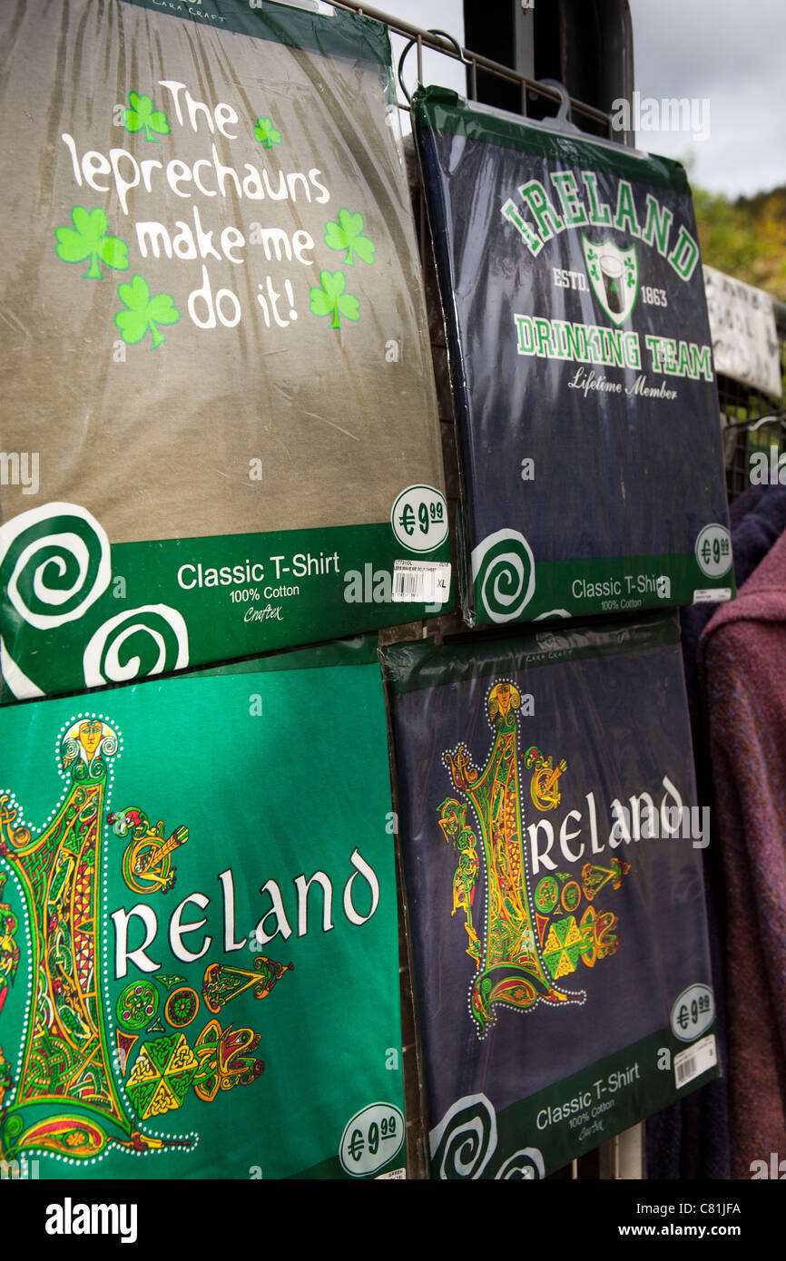 Ireland, Co Wicklow, Glendalough souvenir Tee Shirts on sale at entrance to historic monastic site - Stock Image