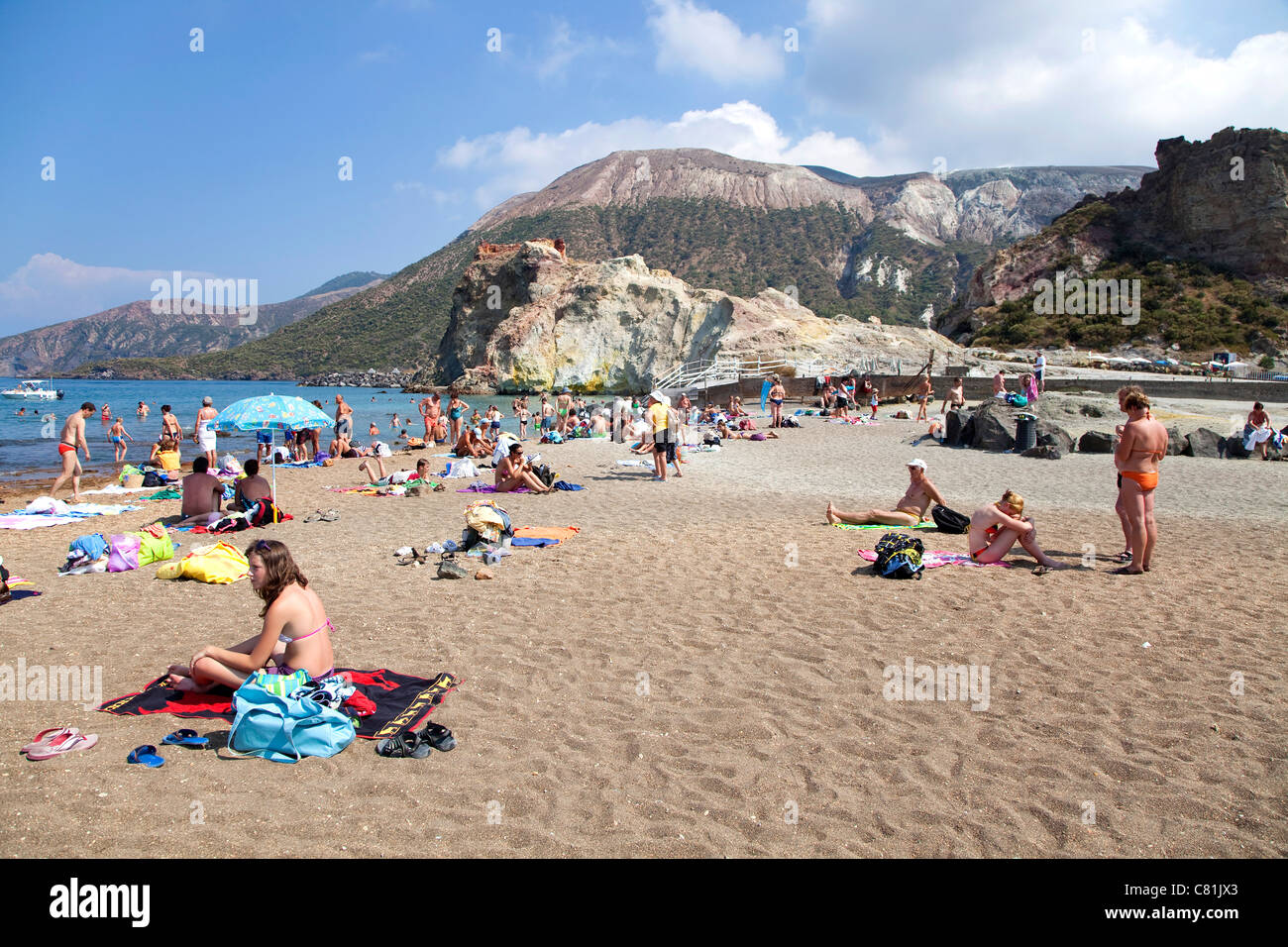 People on the beach, island of Vulcano, active volcano in Eolie, Aeolian Islands, Sicily, Sicilia, Italy - Stock Image