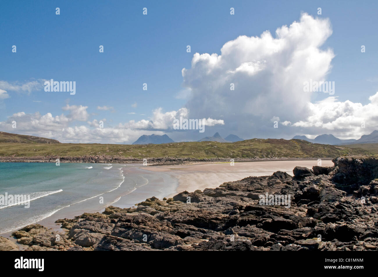 Beach at Achnahaird Bay, Wester Ross, with distant towering cumulonimbus shower cloud - Stock Image
