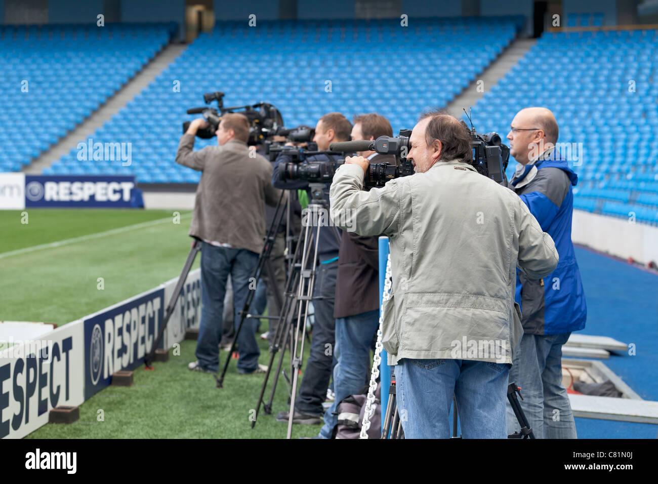 Cameramen filming a sport event, England - Stock Image