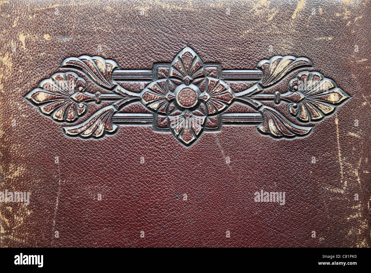worn antique leather with embossed design - Stock Image