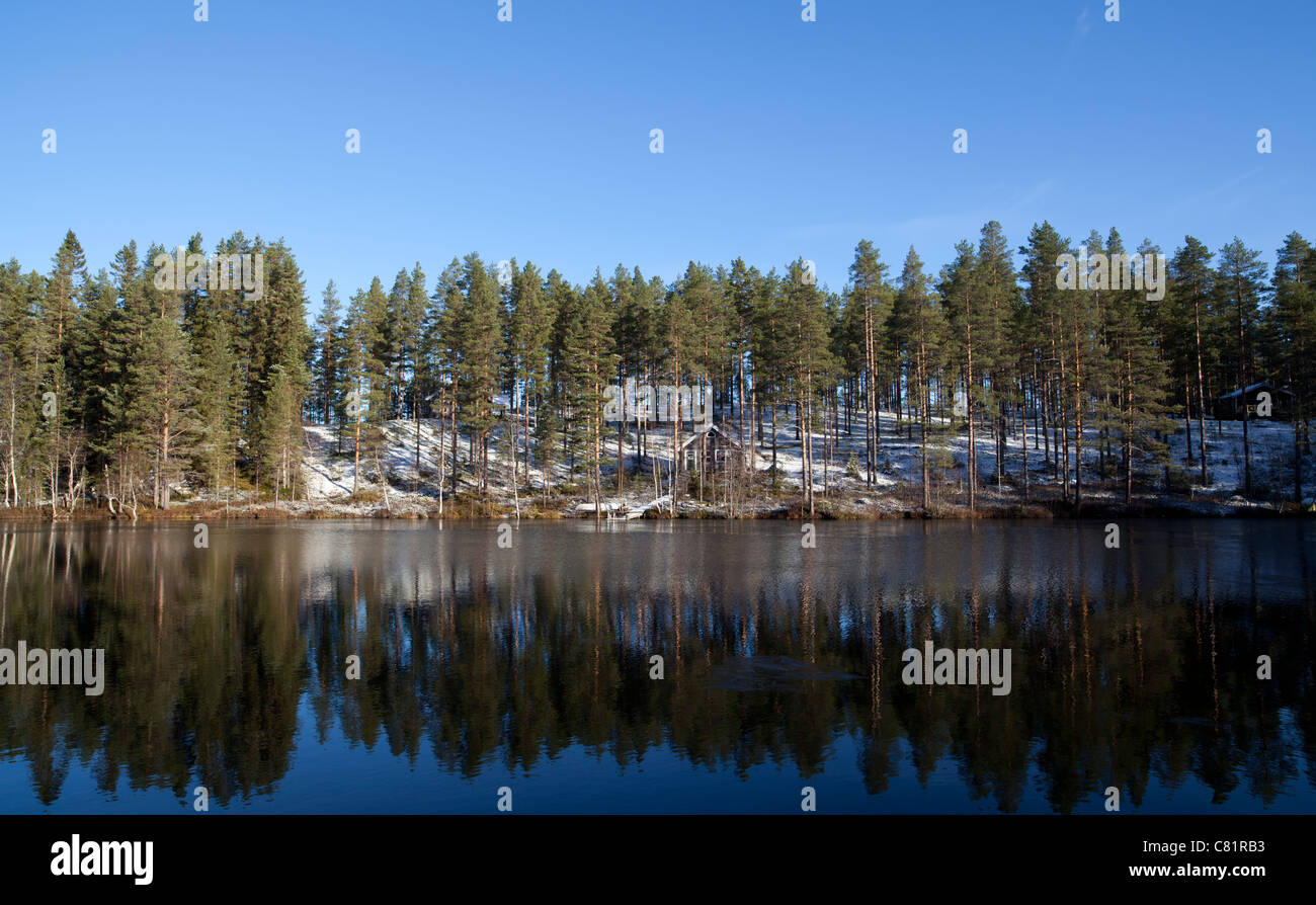 Summer cottages on a forest lake at Autumn , Finland - Stock Image