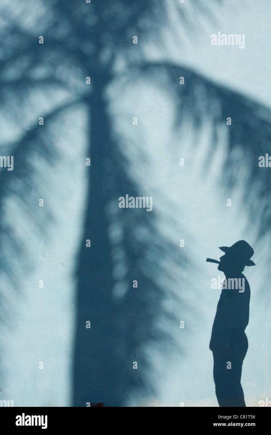 TRINIDAD: SHADOW OF CUBAN MAN SMOKING CIGAR - Stock Image