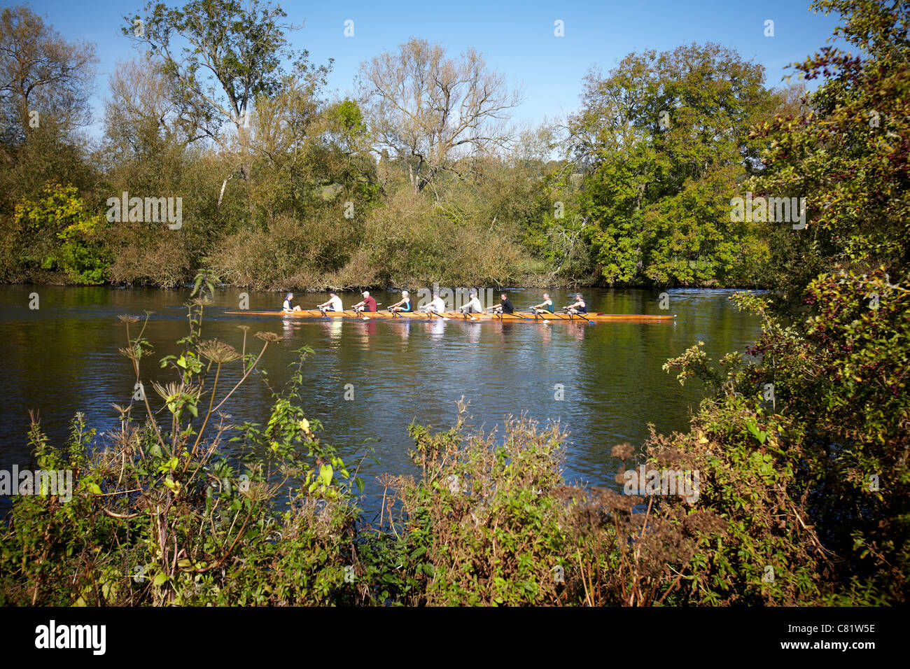 A crew of eight rowers, rowing on the River Thames near to Pangbourne, Reading, Berkshire. - Stock Image