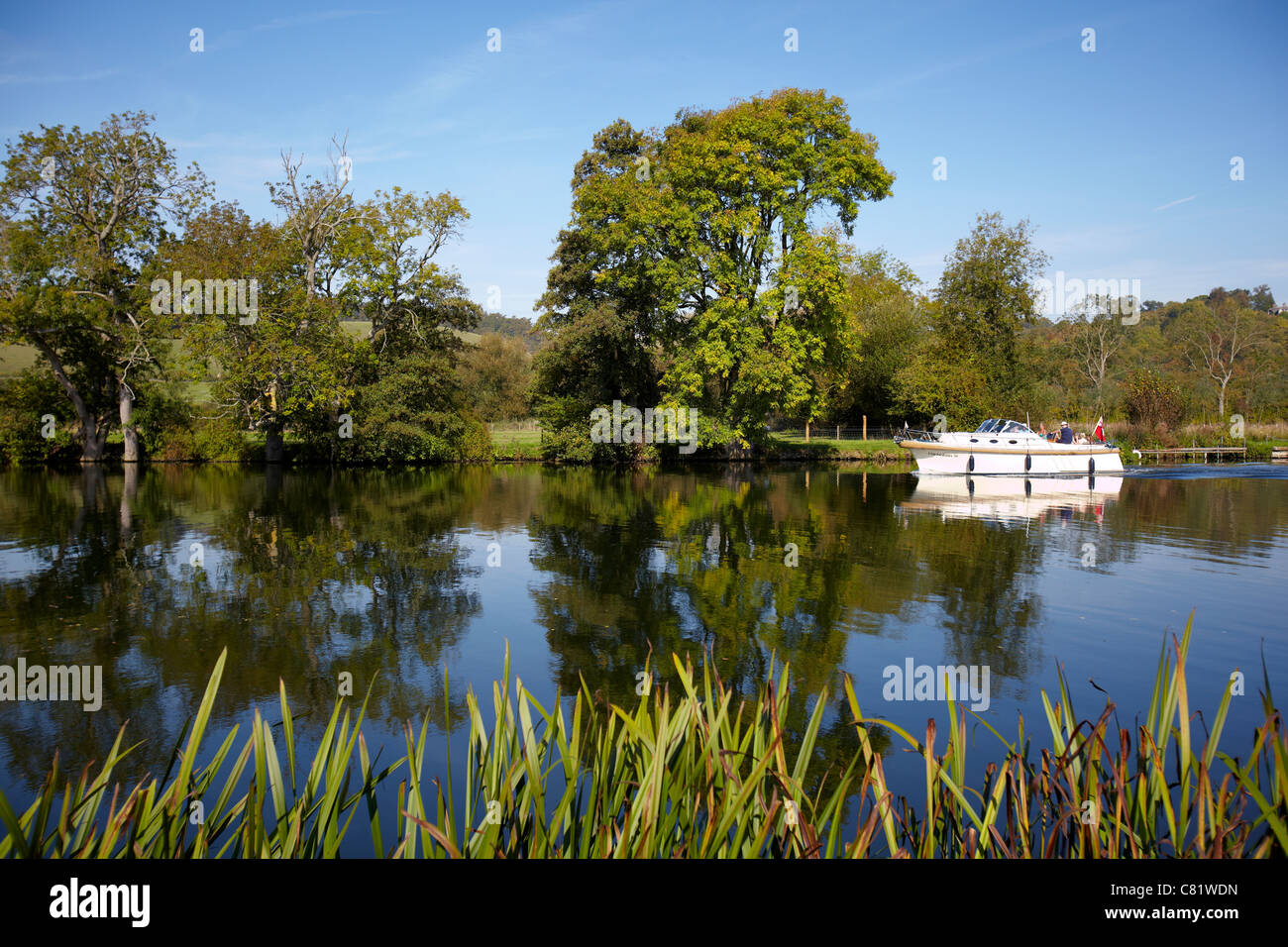 A boat, Cuchulain III, sailing on the River Thames, near Pangbourne, Reading, Berkshire. - Stock Image