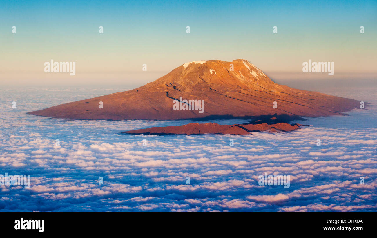 Aerial view of Mount Kilimanjaro lit by the setting sun - Stock Image