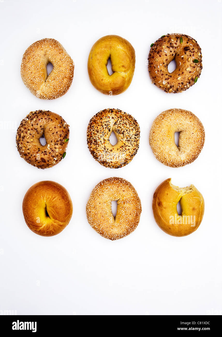 Various bagels, one with bite missing Stock Photo