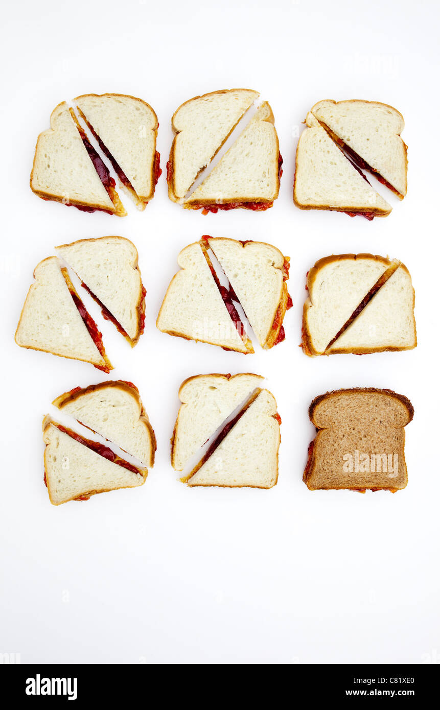 Peanut butter and jelly sandwiches, one on whole wheat bread Stock Photo