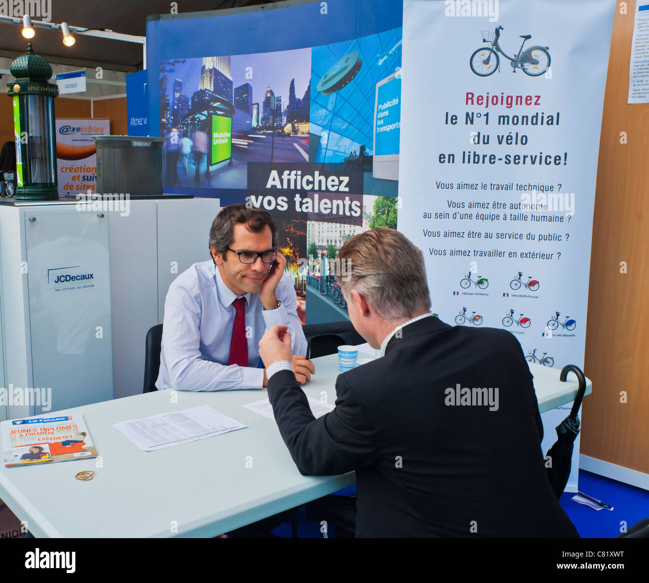 Paris, France, Man at Paris Jobs Fair, Job Seeker at 'J.C. Decaux' Corporation, Urban Advertising and Velib - Stock Image