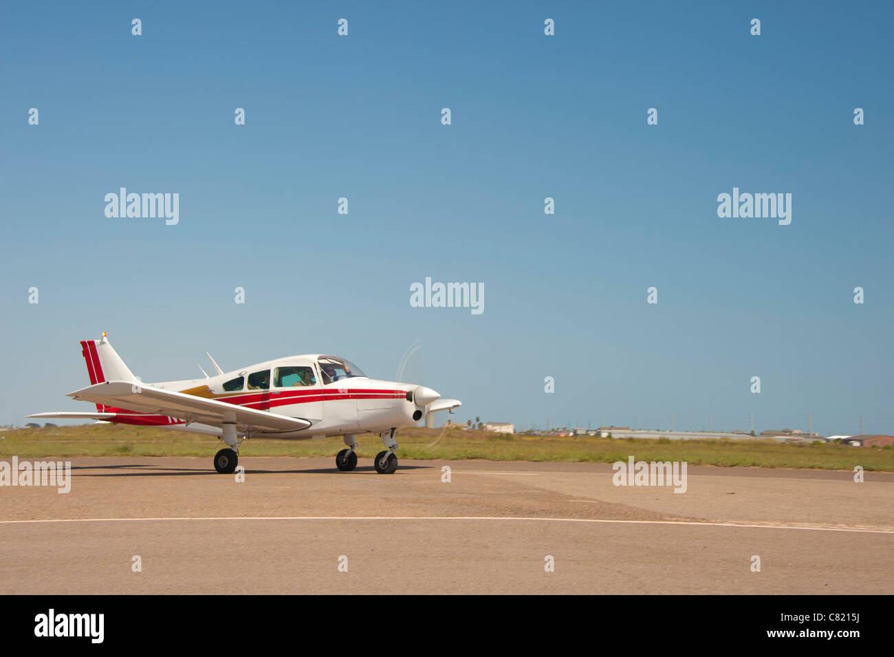 Hawker Beechcraft Airplane on landing field - Stock Image