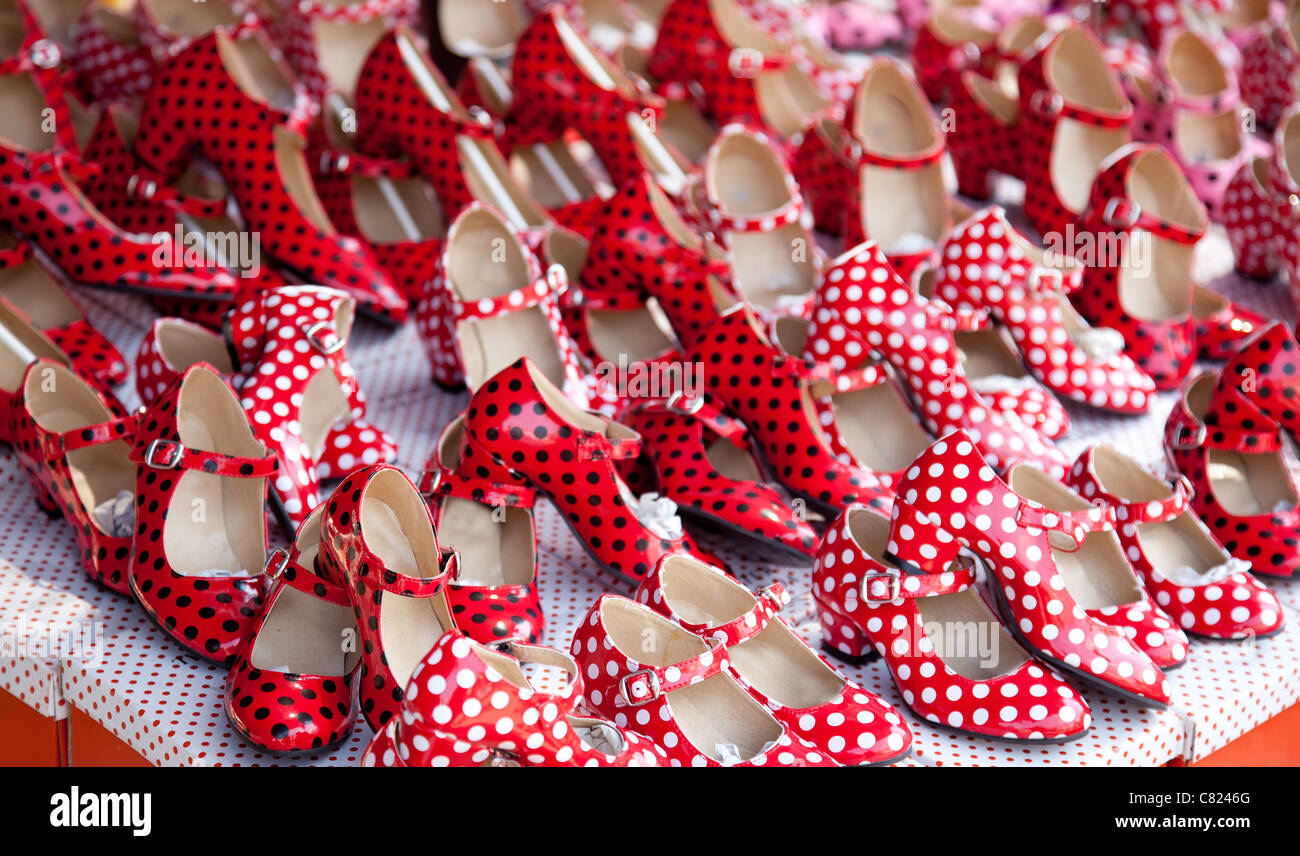 gypsy red shoes with polka dot spots in shop market - Stock Image