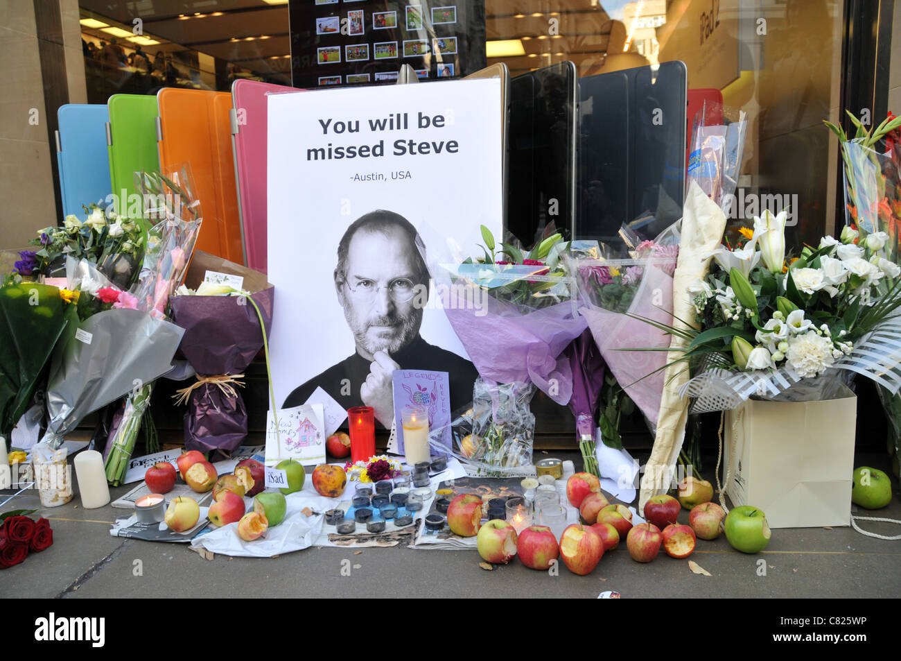steve jobs death memorial shrine apple store flowers apples and cards outside the regent street store london 7th october 2011