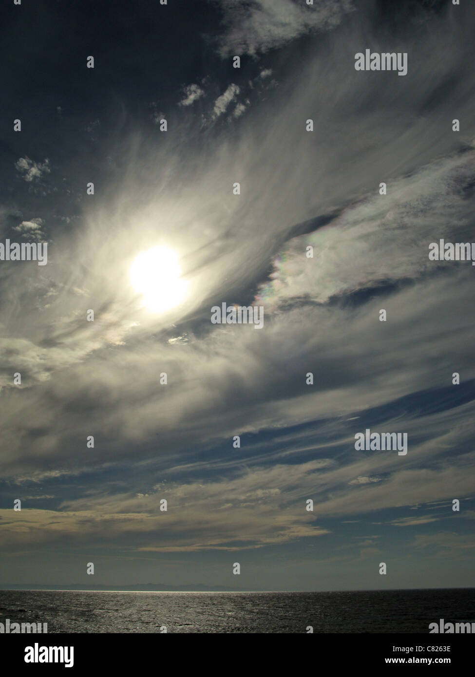 Skyscape with clouds and backlit - Stock Image