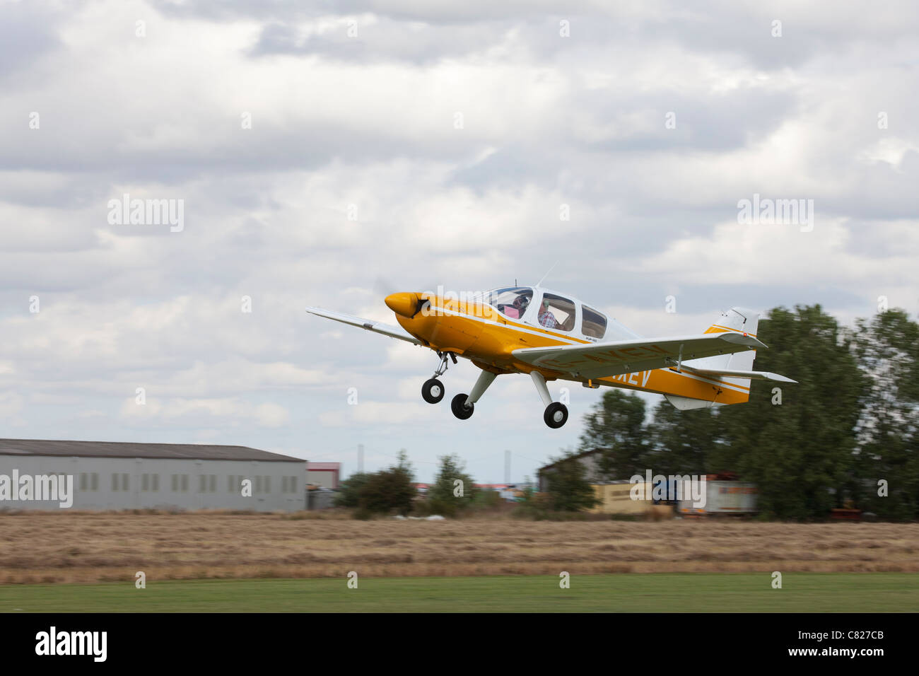 Beagle B121 Series 2 Pup 150 G-AXEV taking-off at Breighton Airfield - Stock Image