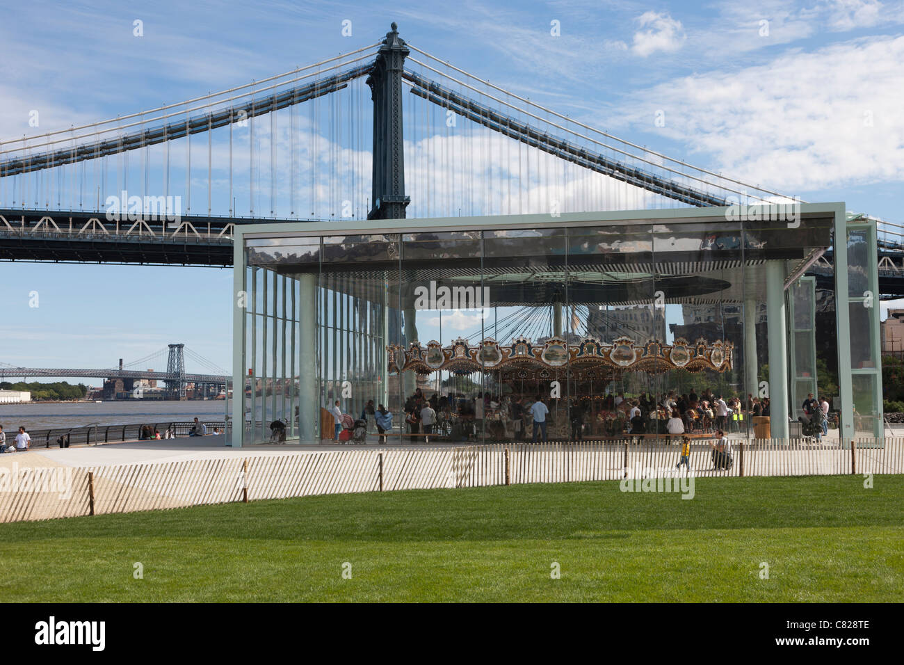 The historic Jane's Carousel in Brooklyn Bridge Park near the Manhattan Bridge in New York City. - Stock Image