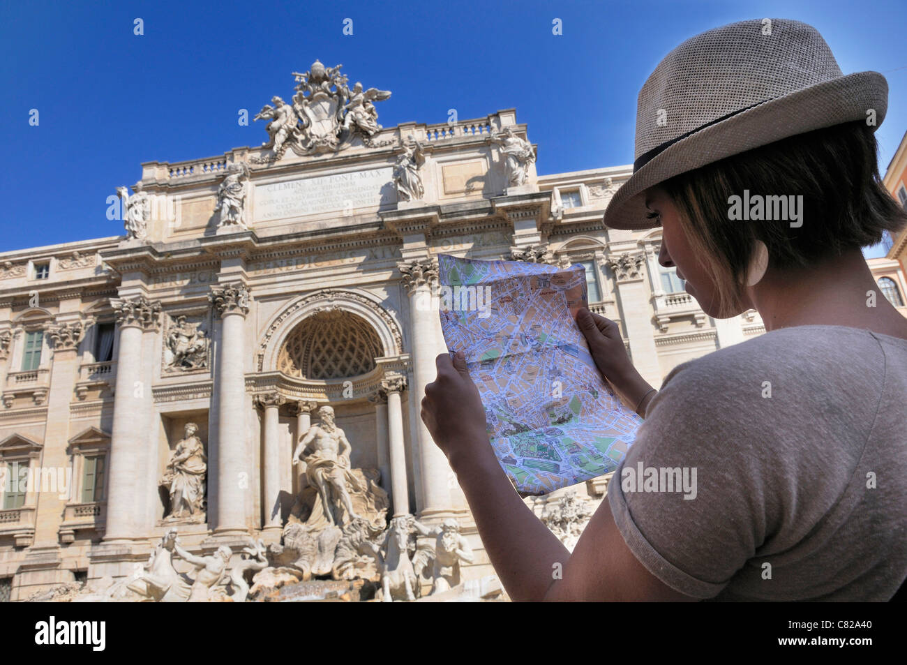 Tourist looking a map at the Trevi Fountain in Rome, Italy - Stock Image
