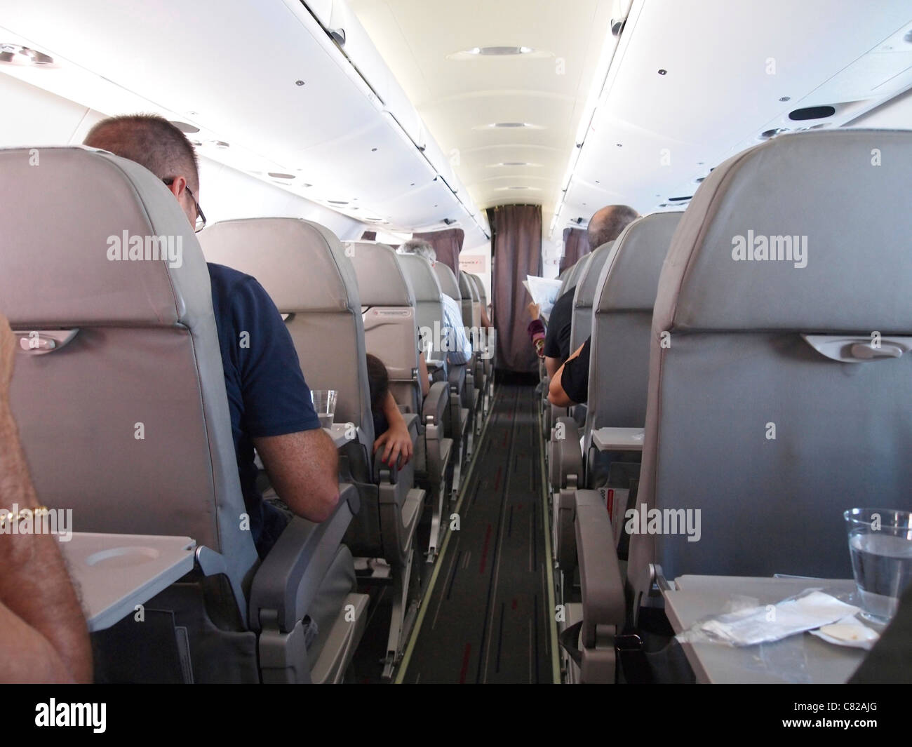 Aeroplane passengers on an airplane - Stock Image