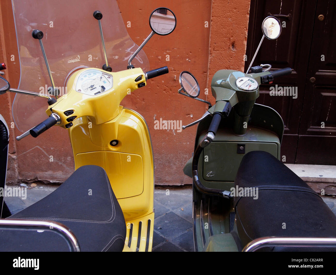 Motor scooters / vespas in the centre of Rome, Italy - Stock Image