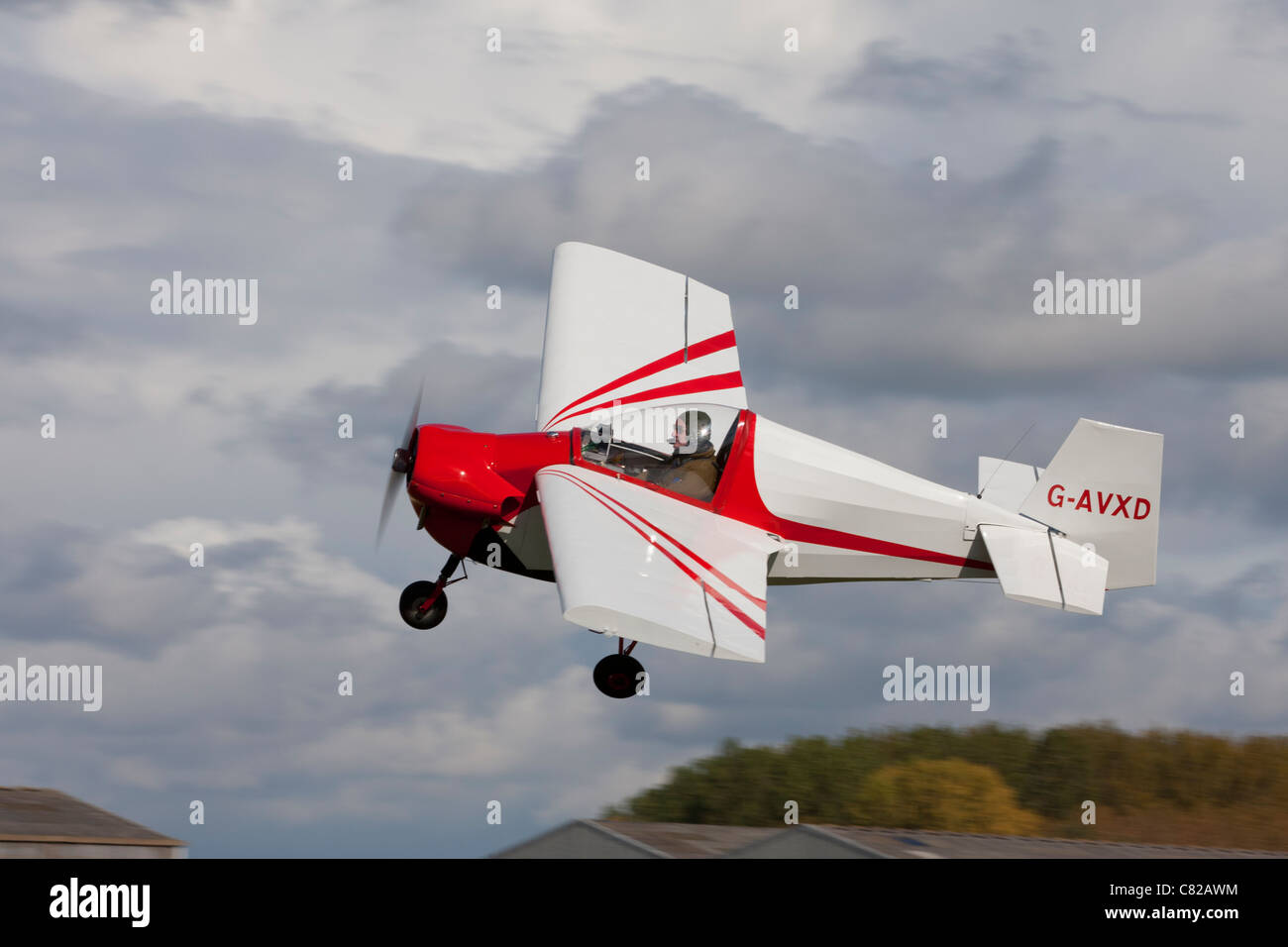 Tipsy T.66 RA45 Series 3 Nipper G-AVXD in flight at Breighton Airfield - Stock Image