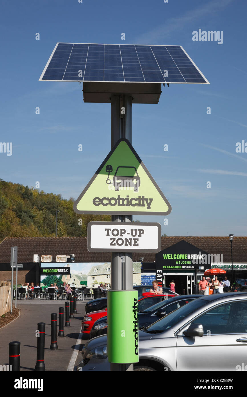 Ecotricity free solar powered charging point for recharging electric battery powered vehicles in motorway services - Stock Image