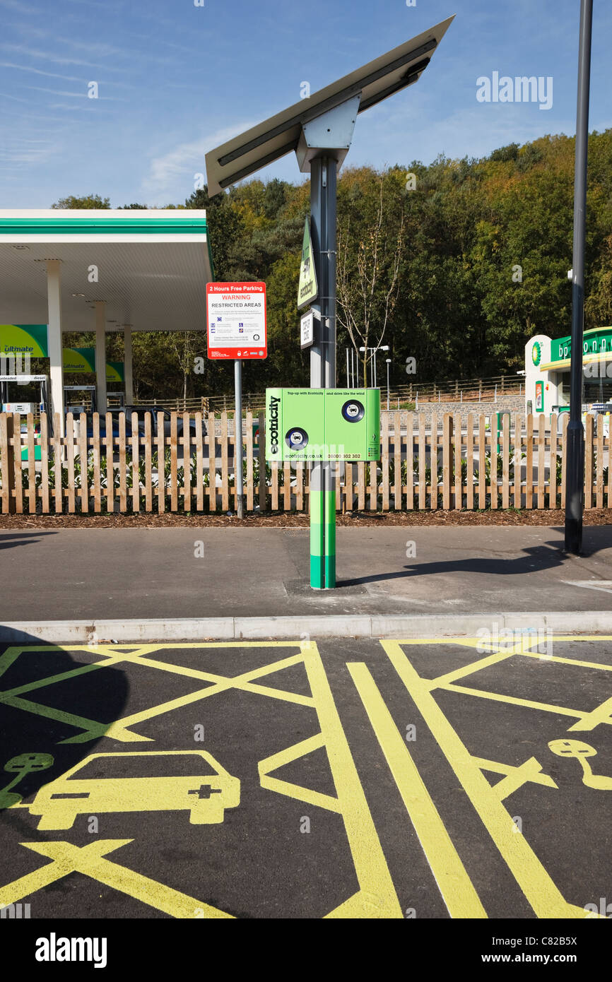 Ecotricity free solar powered electric charging points for recharging electric battery powered vehicles in a motorway - Stock Image