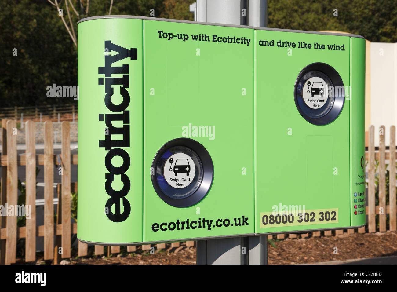 England, UK, Britain. Ecotricity charging point for recharging electric battery powered vehicles in a motorway service Stock Photo